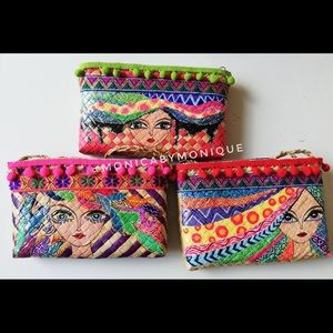 Hand painted sling bags.